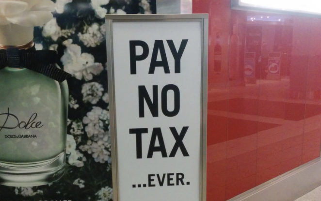 Pay No Tax Ever sign, duty free, sign, Pearson Airport T3, Toronto, ON, Canada by Cory Doctorow (CC BY-SA 2.0) https://flic.kr/p/nuuRgK